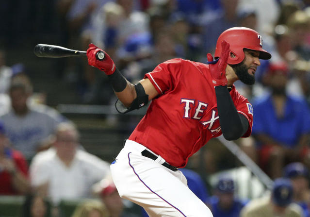 Texas Rangers right fielder Nomar Mazara (30) hits an RBI single against the Los Angeles Dodgers in the third inning of a baseball game Tuesday, Aug. 28, 2018, in Arlington, Texas. (AP Photo/Richard W. Rodriguez)