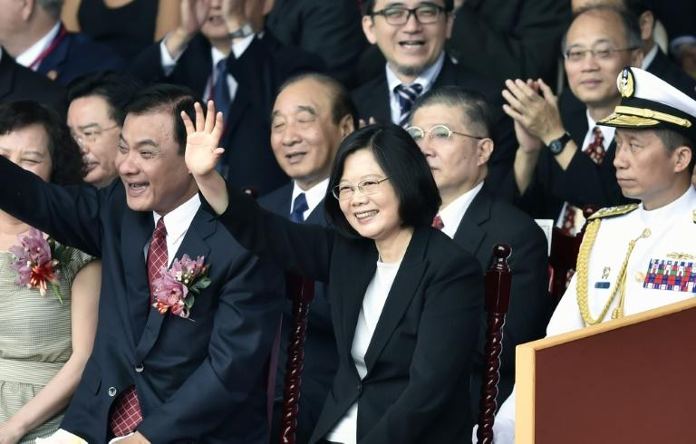 Taiwan's President Tsai Ing-wen (C) waves during National Day celebrations, in front of the Presidential Palace in Taipei, on October 10, 2016