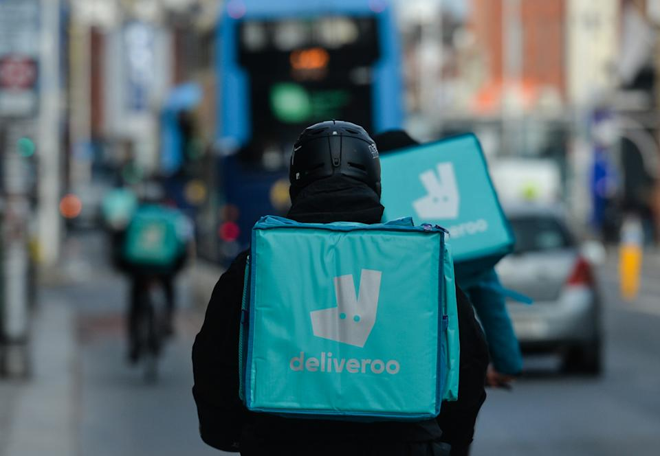 DUBLIN, IRELAND - 2021/02/13: Deliveroo couriers seen in Dublin city center, during the COVID-19 pandemic lockdown. Level 5 lockdown restrictions are set to be extended by Irish Government, by at least another six weeks with only schools and the construction sector likely to be allowed to reopen before Easter. (Photo by Cezary Kowalski/SOPA Images/LightRocket via Getty Images)