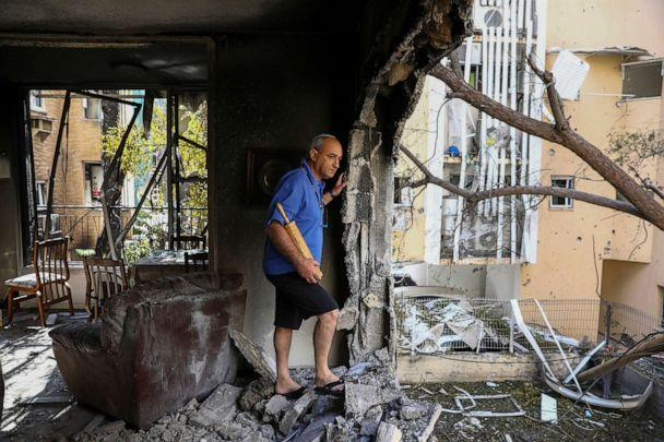 PHOTO: A member of Sror family inspect the damage of their apartment after being hit by a rocket fired from the Gaza Strip over night, in Petah Tikva, central Israel, May 13, 2021. (Oded Balilty/AP)