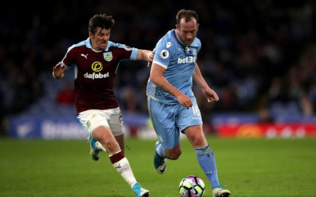 <span>Charlie Adam protects the ball from Joey Barton</span> <span>Credit: PA </span>