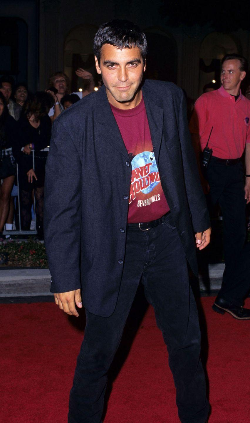 <p>Clooney attends the Planet Hollywood Beverly Hills Grand Opening in 1995.</p>