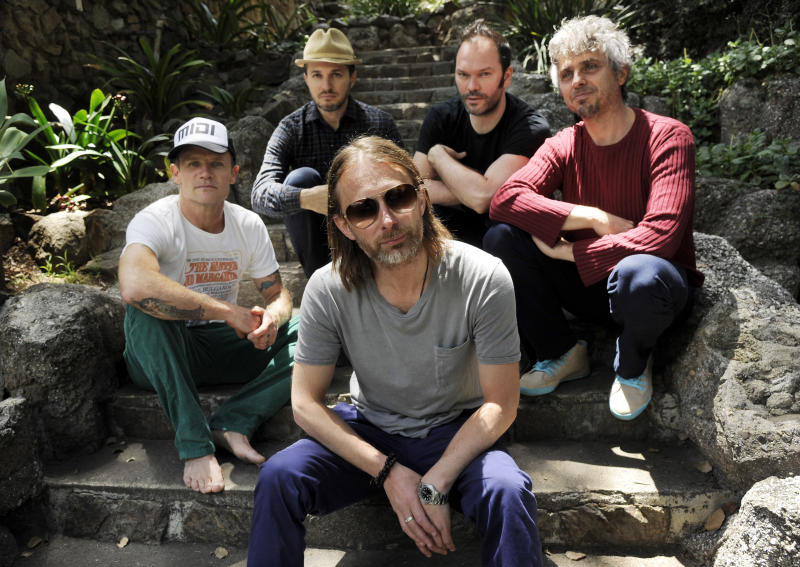 This May 22, 2013, photo shows members of the band Atoms For Peace, from left, Flea, Joey Waronker, Thom Yorke, foreground center, Nigel Godrich and Mauro Refosco posing for a portrait in Los Angeles. The band's 27-date tour begins in July in Europe and will reach the US in September before ending in Japan. (Photo by Chris Pizzello/Invision/AP)