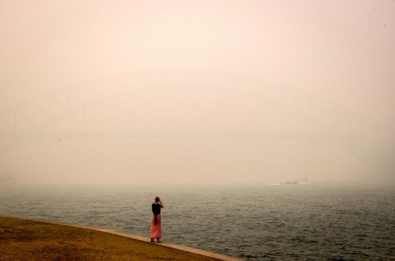 The Sydney Harbour Bridge is enveloped in haze caused by nearby bushfires on December 10