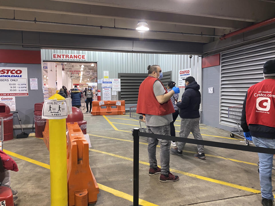 Long line of shoppers waiting to get into Costco Store, Social Distancing, Queens Center Mall. (Photo by: Lindsey Nicholson/Education Images/Universal Images Group via Getty Images)