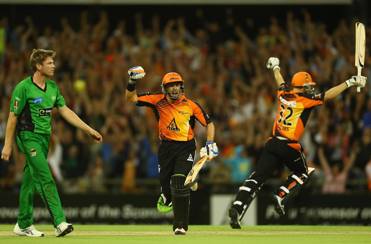 PERTH, AUSTRALIA - JANUARY 16:  Michael Hussey and Adam Voges of the Perth Scorchers celebrate after the Scorchers defeated the Stars during the Big Bash League semi-final match between the Perth Scorchers and the Melbourne Stars at the WACA on January 16, 2013 in Perth, Australia.  (Photo by Robert Cianflone/Getty Images)