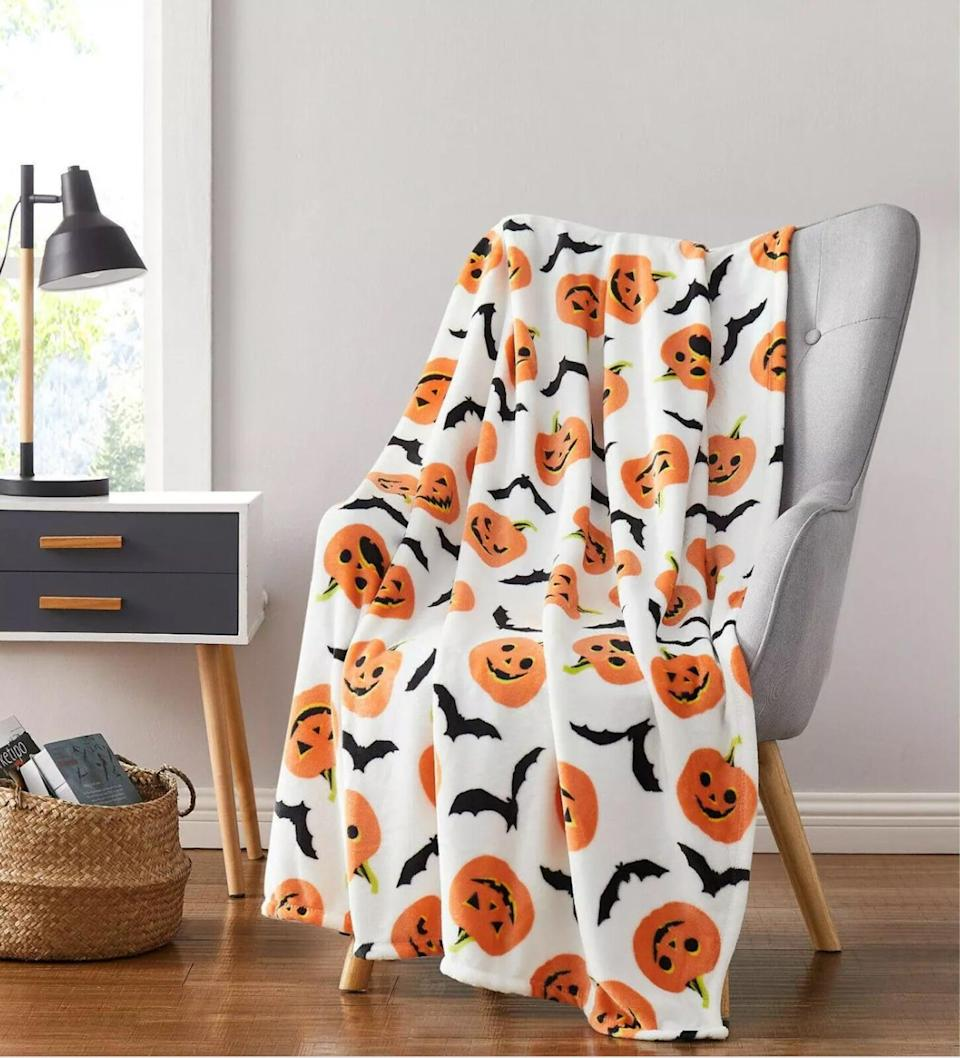 <p>Cozy up with this adorable <span>Halloween Pumpkins and Bats Ultra Soft and Plush Throw Blanket</span> ($26, originally $40).</p>