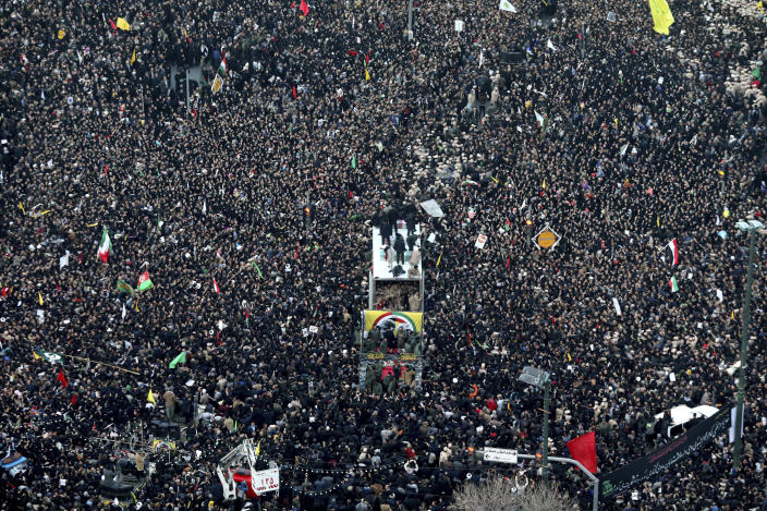 Coffins of Gen. Qassem Soleimani and others who were killed in Iraq by a U.S. drone strike, are carried on a truck surrounded by mourners during a funeral procession, in the city of Mashhad, Iran, Sunday, Jan. 5, 2020. Soleimani's death Friday in Iraq further heightens tensions between Tehran and Washington after months of trading attacks and threats that put the wider Middle East on edge. (Mohammad Hossein Thaghi/Tasnim News Agency via AP)
