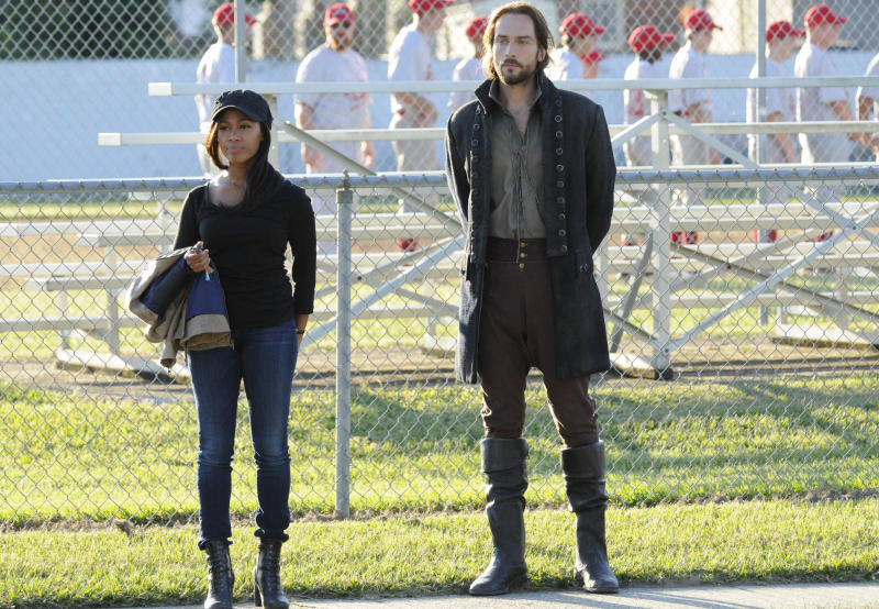 """In this Sept. 26, 2013 photo provided by Fox, the stars of """"Sleepy Hollow"""" appear in a scene from the TV show. Nicole Beharie, left, plays police Lt. Abbie Mills and Tom Mison plays Ichabod Crane. The new show, inspired by the tale of the Headless Horseman, has spurred interest in the village of Sleepy Hollow, N.Y. (AP Photo/Fox)"""
