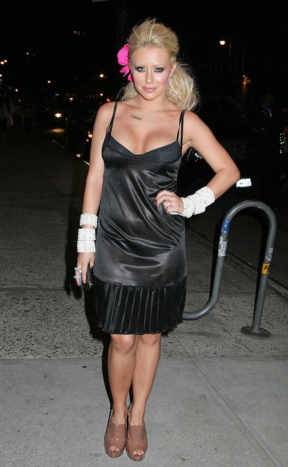 "Danity Kane ""singer"" Aubrey O'Day continues to disappoint in this foul flapper frock, mismatched shoes, awful accessories, and monstrous eye makeup. Jose Perez/<a href=""http://www.infdaily.com"" target=""new"">INFDaily.com</a> - July 1, 2008"