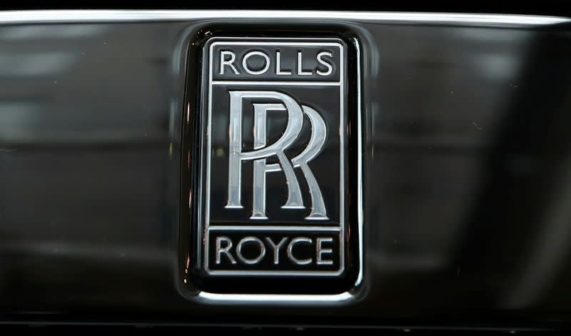 FILE PHOTO: The badge of a Rolls-Royce Black Badge Dawn car is seen at a dealership in London