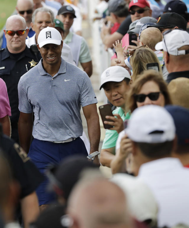 Tiger Woods smiles as he greets fans on the 14th hole during the pro-am round of the BMW Championship golf tournament at Medinah Country Club, Wednesday, Aug. 14, 2019, in Medinah, Ill. (AP Photo/Nam Y. Huh)