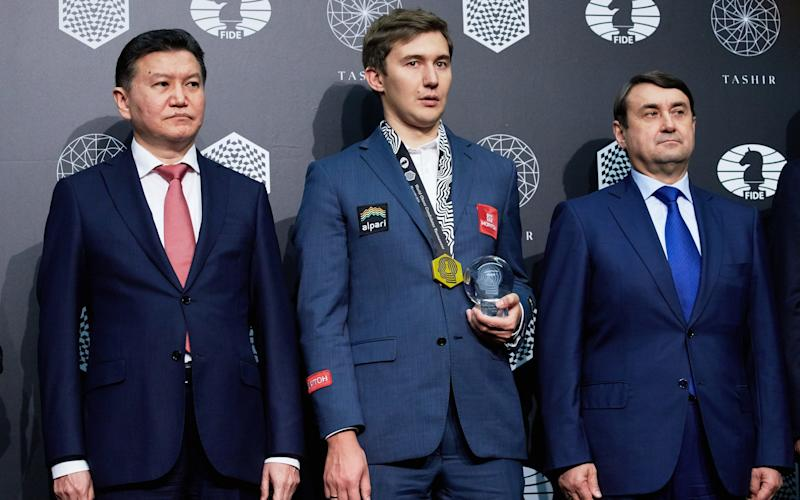 Kirsan Ilyumzhinov at the 2016 Candidates tournament presentation with Russian grandmaster Sergey Karjakin - Credit: Oleg Nikishin/Getty Images for World Chess