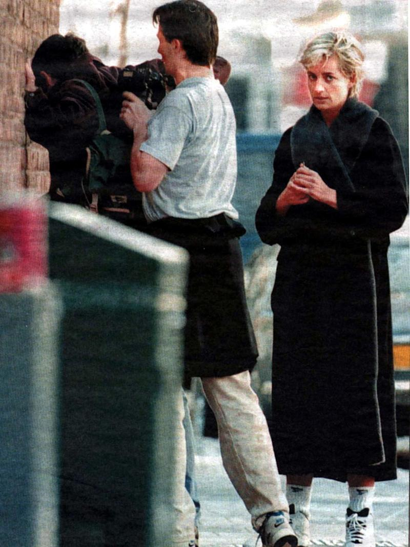 A passerby relieves photographer Brendan Beirne of the pictures he took of Diana exiting a gym in April 1997 after shecomplained ofharassment (Photo: Rex Features )