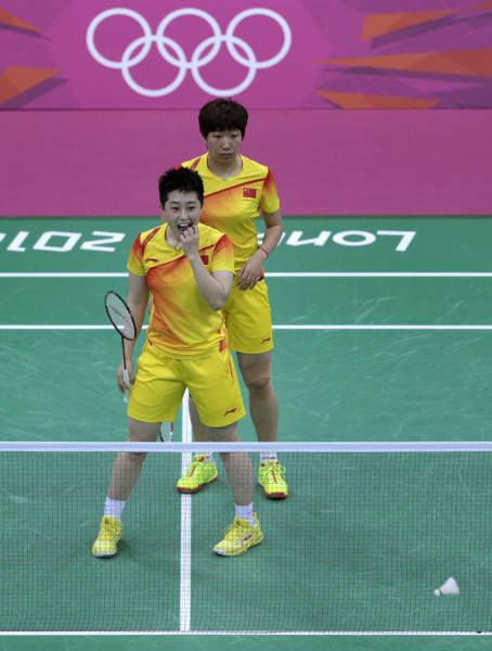 World doubles champions Yu Yang, left, and Wang Xiaoli, of China, watch as the shuttlecock hits the net during their women's doubles badminton match against South Korea's Jung Kyung-eun and Kim Ha-na, unseen, at the 2012 Summer Olympics, Tuesday, July 31, 2012, in London. Wang and Yu and their South Korean opponents were booed loudly at the Olympics on Tuesday for appearing to try and lose their group match in Wembley Arena to earn an easier draw. (AP Photo/Saurabh Das)