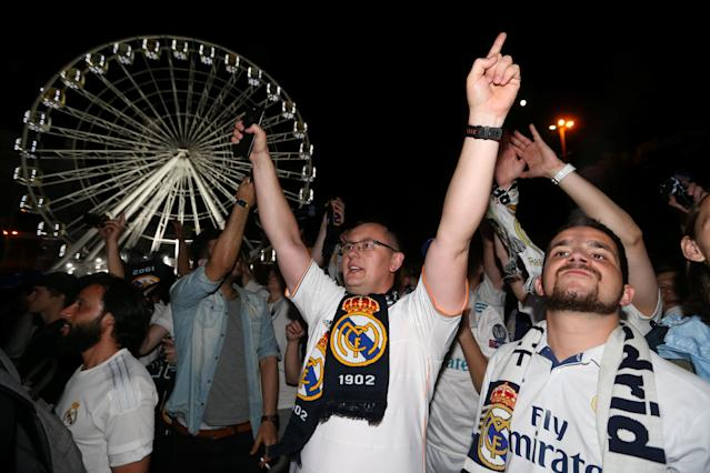 Soccer Football - Champions League Final - Real Madrid v Liverpool - Kiev, Ukraine - May 26, 2018 Real Madrid fans celebrate after watching the match on a television screen outside the stadium REUTERS/Viacheslav Ratynskyi