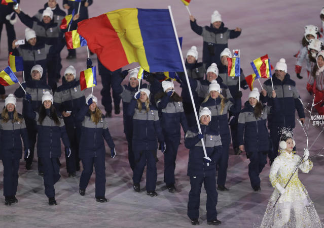 <p>Marius Ungureanu carries the flag of Romania during the opening ceremony of the 2018 Winter Olympics in Pyeongchang, South Korea, Friday, Feb. 9, 2018. (AP Photo/Michael Sohn) </p>