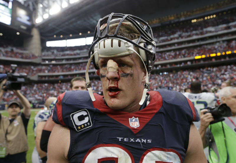 FILE - In this Sunday, Sept. 29, 2013 file photo, a bloodied Houston Texans' J.J. Watt walks off the field after the team's overtime loss to the Seattle Seahawks in an NFL football game in Houston. Watt's penchant for violent collisions resulted in a deep gash on the bridge of his nose during the game, which required six stitches. The gash kept opening in subsequent games, so now that the season is winding down, Watt tells The Associated Press he'll look into having plastic surgery in the offseason to repair the injury. (AP Photo/David J. Phillip, File)