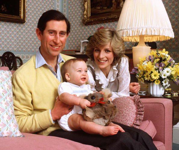 <p>Prince Charles and Princess Diana pose with Prince William, who clutches her favorite toy, a koala bear.</p>