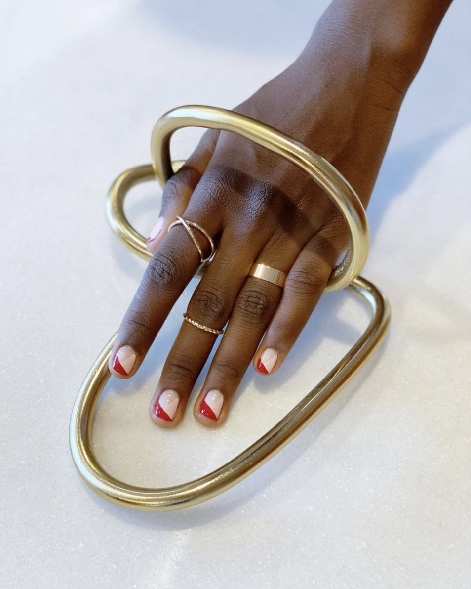 Have you ever seen Christmas nail art that looks so perfect with gold jewelry. Didn't think so. Make like nail art Queenie Nguyen and top off a pale pink base with an unexpected, slanted red tip.