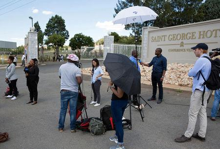 Members of the media gather outside a hotel where members of the African National Congress (ANC) National Executive Committee are meeting to decide the fate of President Jacob Zuma, in Pretoria, South Africa, February 12, 2018. REUTERS/James Oatway