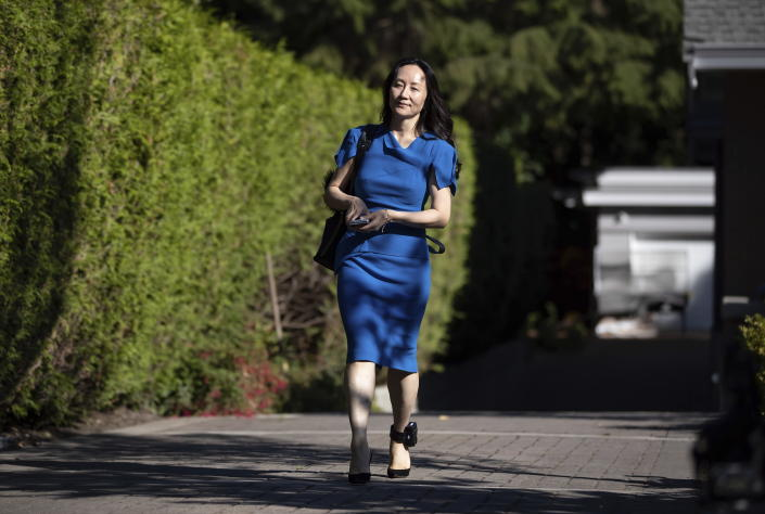 Meng Wanzhou, chief financial officer of Huawei, leaves home to attend her extradition hearing at B.C. Supreme Court, in Vancouver, B.C., Wednesday, Aug. 4, 2021. (Darryl Dyck/The Canadian Press via AP)