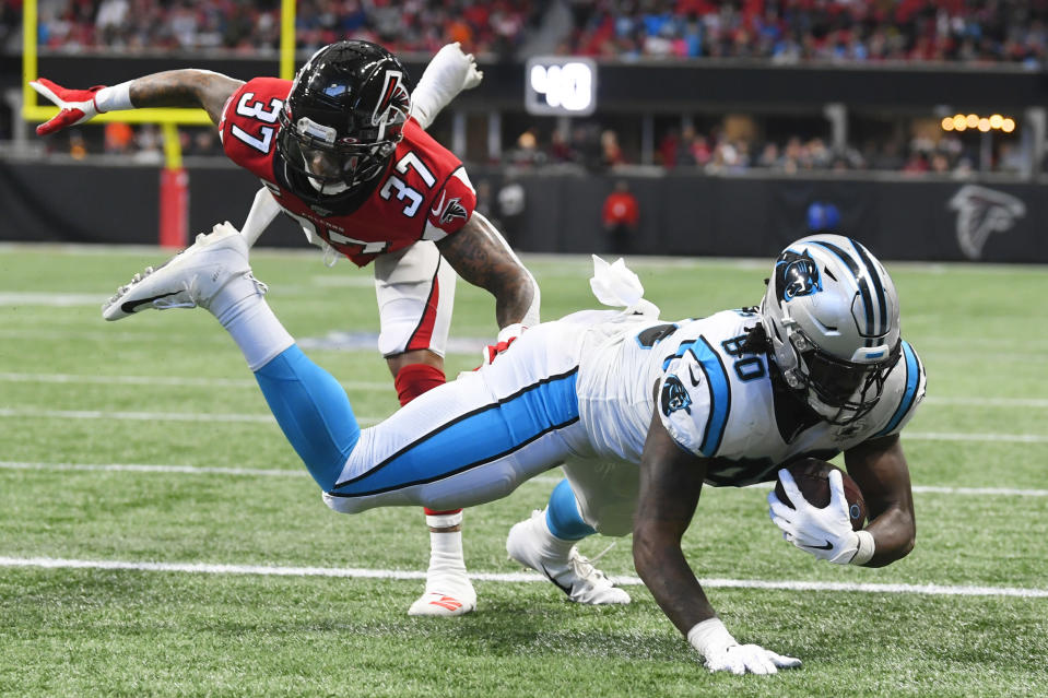 Atlanta Falcons free safety Ricardo Allen (37) hits Carolina Panthers tight end Ian Thomas (80) as Thomas scores a touchdown during the first half of an NFL football game, Sunday, Dec. 8, 2019, in Atlanta. (AP Photo/John Amis)