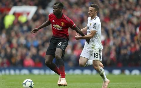 Paul Pogba and Diogo Jota compete for the ball - Paul Pogba and Diogo Jota compete for the ball - Credit: Getty Images