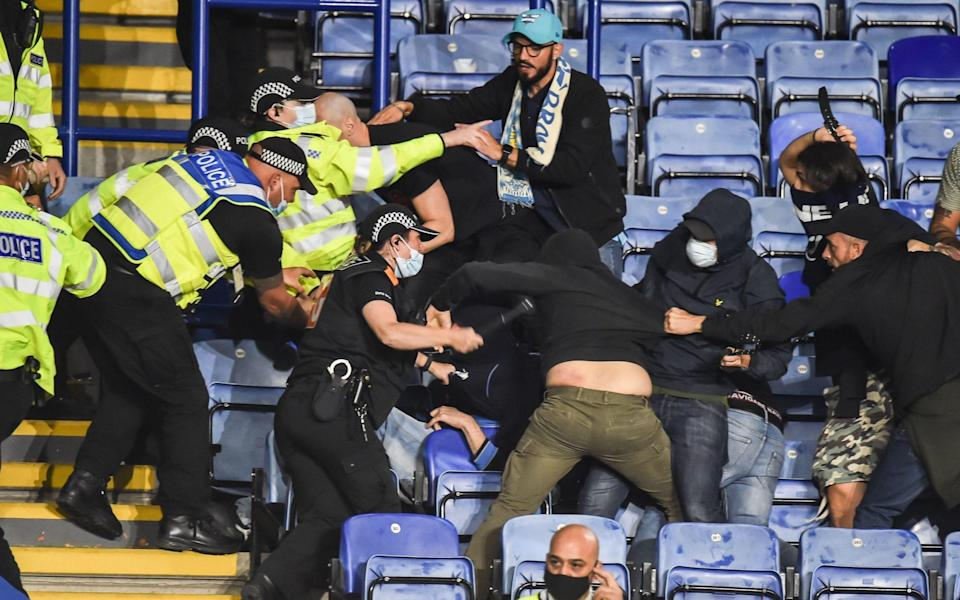 Napoli ultras fight with Leicester City fans and police as violence mars Europa League clash - EPA