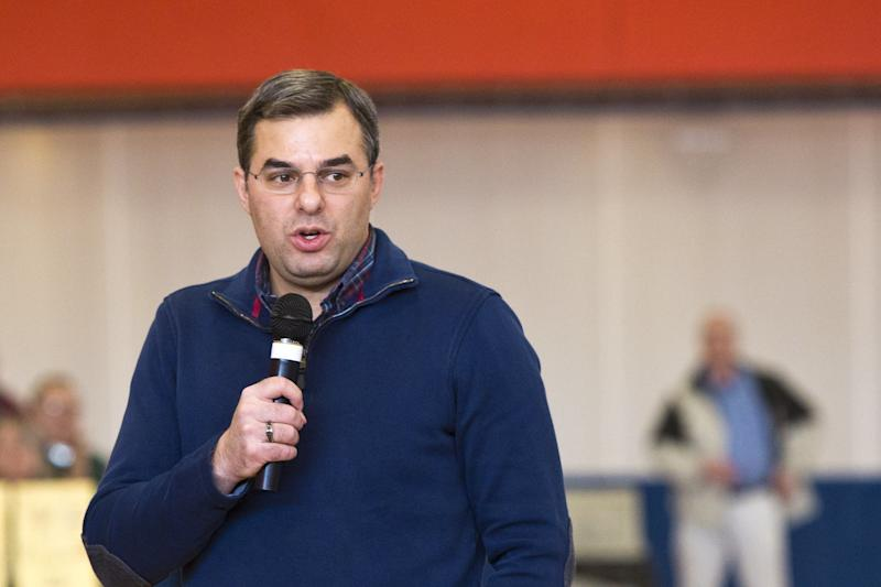 U.S Rep. Justin Amash, R-Cascade Township, speaks to the audience during a town hall meeting on Thursday, Feb. 23, 2017 at the Full Blast Recreation Center in Battle Creek, Mich. (Carly Geraci/Kalamazoo Gazette-MLive Media Group via AP)