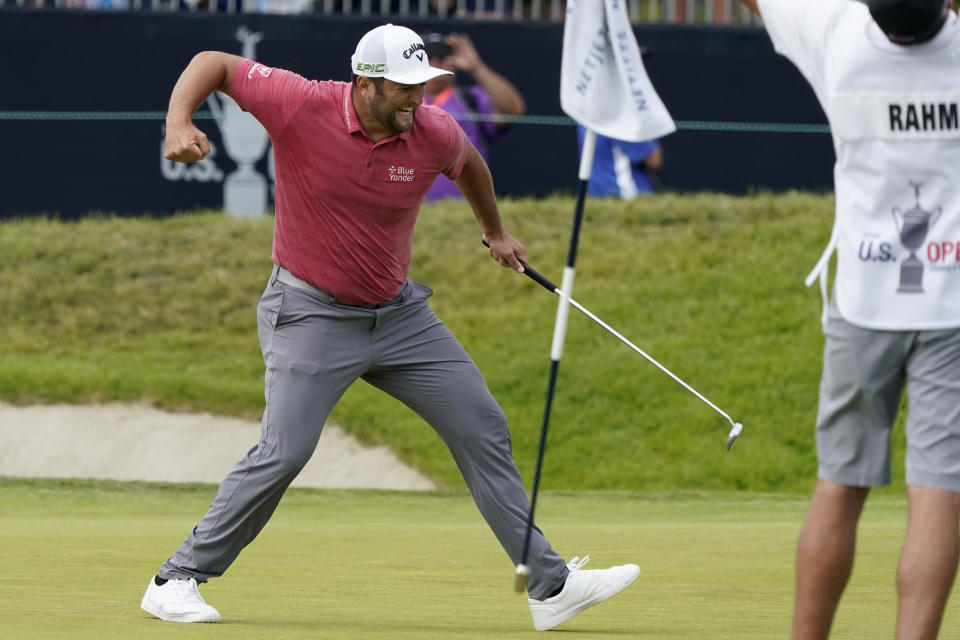 Jon Rahm, of Spain, pumps his fist after making his birdie putt on the 18th green during the final round of the U.S. Open Golf Championship, Sunday, June 20, 2021, at Torrey Pines Golf Course in San Diego. (AP Photo/Marcio Jose Sanchez)