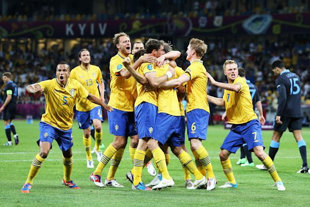 KIEV, UKRAINE - JUNE 15: Sweden celebrate after Olof Mellberg of Sweden scored their first goal during the UEFA EURO 2012 group D match between Sweden and England at The Olympic Stadium on June 15, 2012 in Kiev, Ukraine. (Photo by Scott Heavey/Getty Images)