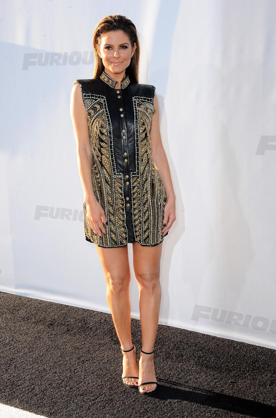 """Maria Menounos looked fierce in a leather and gold metal accented Balmian mini. The TV personality was on hand to cover the event and got nostalgic on Instagram prior to the premiere. """"…"""