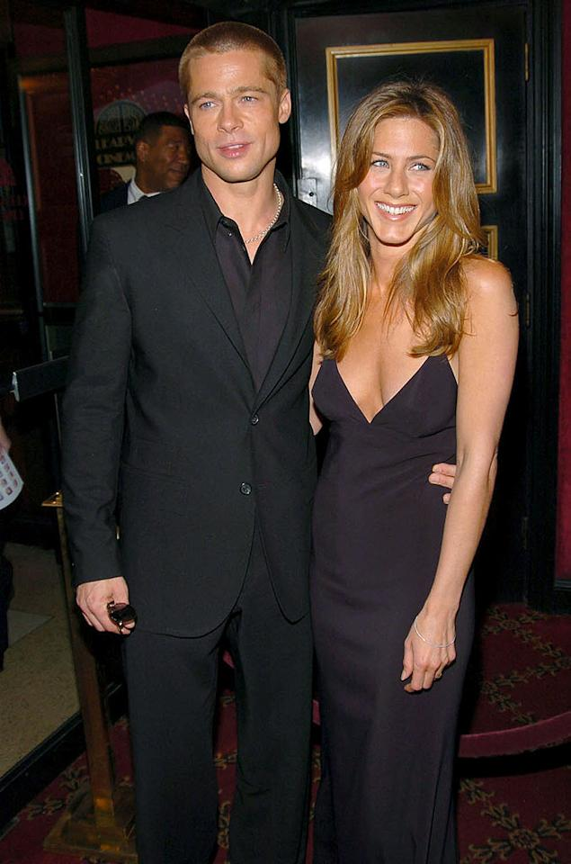 """Jennifer Aniston and Brad Pitt began dating in April 1998, after they were set up by their agents (is there any deal that Hollywood agents <i>won't</i> try to broker?), and the two were married in July 2000. Pitt designed their wedding rings, and wrote vows in which he promised to find a balance on the thermostat. Jen vowed to make Brad his favorite dessert: banana splits. But then ... Kevin Mazur/<a href=""""http://www.wireimage.com"""" target=""""new"""">WireImage.com</a> - May 10, 2004"""