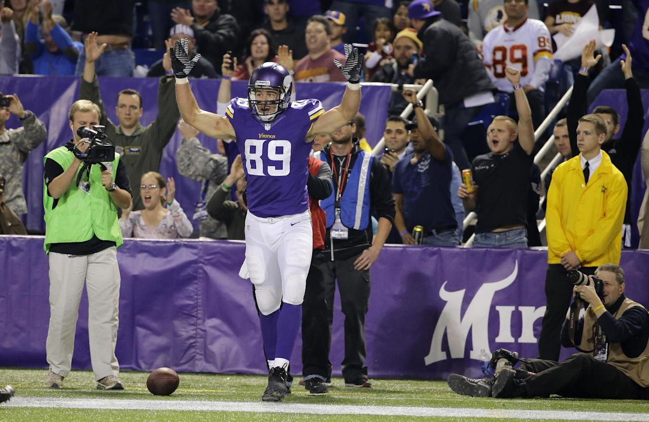 Minnesota Vikings tight end John Carlson reacts after catching a touchdown reception during the second half of an NFL football game against the Washington Redskins, Thursday, Nov. 7, 2013, in Minneapolis. (AP Photo/Ann Heisenfelt)