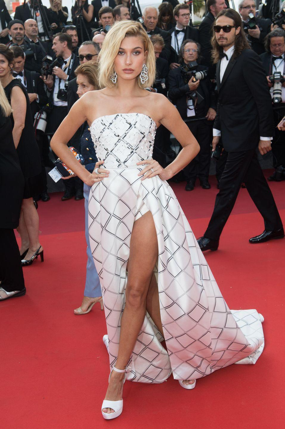 "<p>Hailey Baldwin<span class=""redactor-invisible-space""> wore a white Ralph & Russo gown to attend The Beguiled Cannes film premiere.</span></p>"