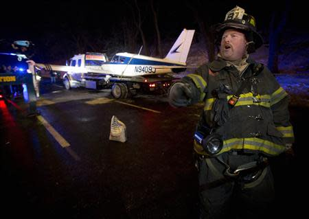 A single engine plane is loaded onto a flat bed truck after landing on Major Deegan Expressway in the Bronx borough of New York January 4, 2014. REUTERS/Carlo Allegri