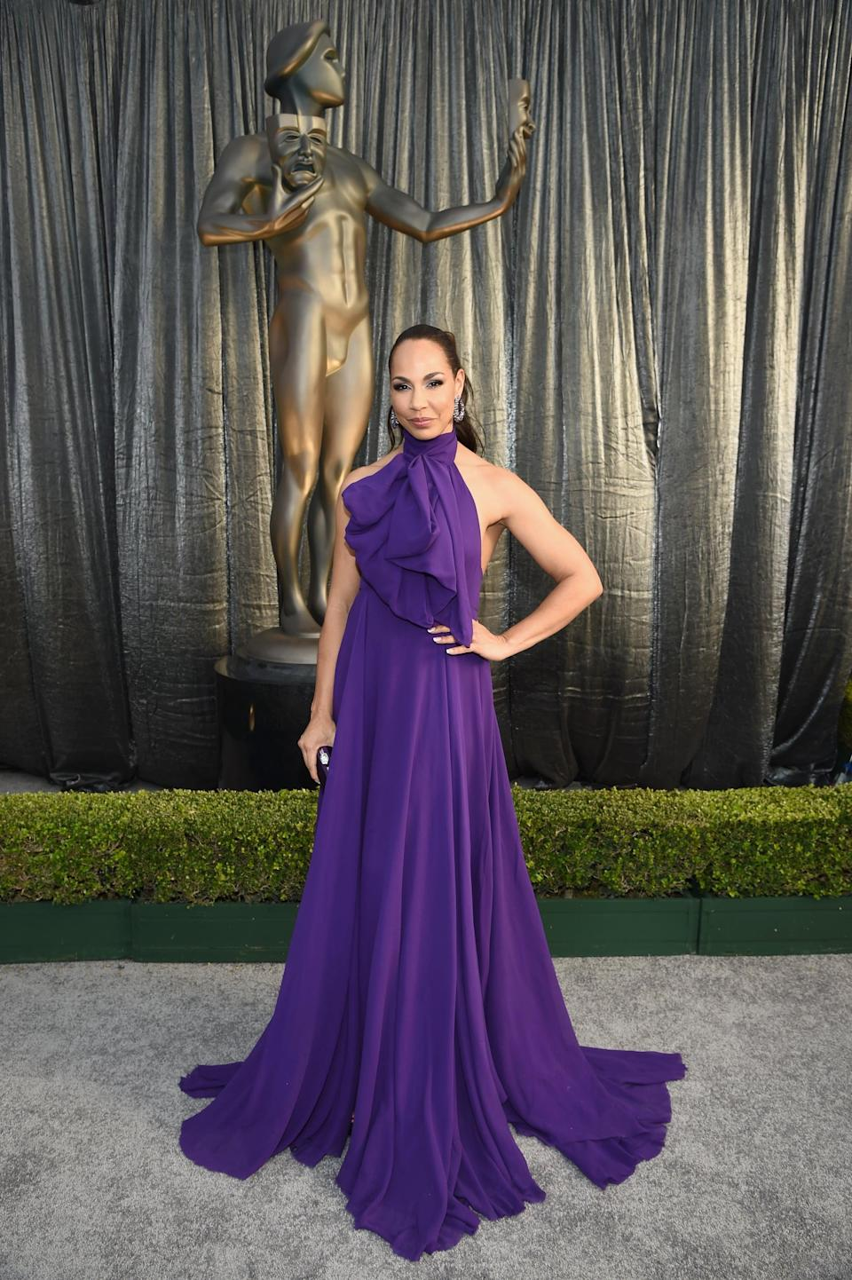 <p>Wearing a purple Redemption gown and Stuart Weitzman shoes.</p>