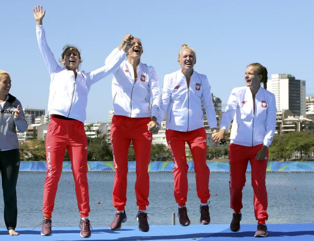 2016 Rio Olympics - Rowing - Victory Ceremony - Women's Quadruple Sculls Victory Ceremony - Lagoa Stadium - Rio De Janeiro, Brazil - 11/08/2016. Maria Springwald (POL) of Poland, Joanna Leszczynska (POL) of Poland, Agnieszka Kobus (POL) of Poland, Monika Ciaciuch (POL) of Poland celebrate bronze medal. REUTERS/Gonzalo Fuentes FOR EDITORIAL USE ONLY. NOT FOR SALE FOR MARKETING OR ADVERTISING CAMPAIGNS.