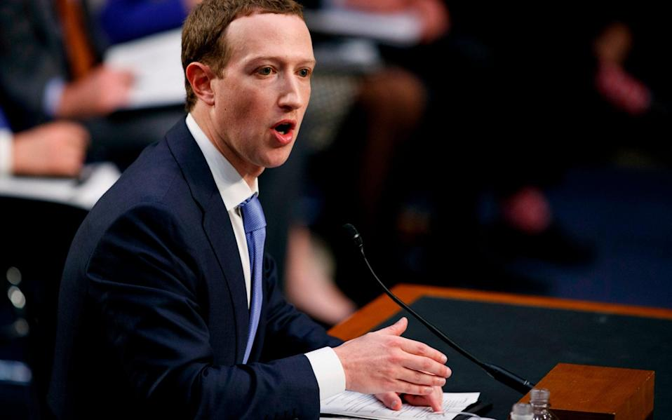 Facebook CEO Mark Zuckerberg testifies before a joint hearing of the Commerce and Judiciary Committees on Capitol Hill in Washington, Tuesday, April 10, 2018, about the use of Facebook data to target American voters in the 2016 election - Carolyn Kaster/AP