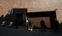 Members of Presidential Security Service stand outside of a residence of former President Lee Myung-bak in Seoul, South Korea, Thursday, Oct. 29, 2020. South Korea's top court upheld a 17-year sentence imposed on former President Lee for a range of corruption crimes in a final ruling Thursday that will send him back to prison. (AP Photo/Lee Jin-man)