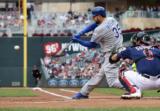 Kansas City Royals' Eric Hosmer hits a single off Minnesota Twins pitcher Ricky Nolasco in the first inning of a baseball game, Tuesday, July 1, 2014, in Minneapolis. (AP Photo/Jim Mone)