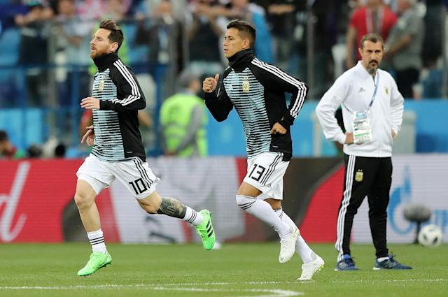 Soccer Football - World Cup - Group D - Argentina vs Croatia - Nizhny Novgorod Stadium, Nizhny Novgorod, Russia - June 21, 2018 Argentina's Lionel Messi and Maximiliano Meza during the warm up before the match REUTERS/Ivan Alvarado