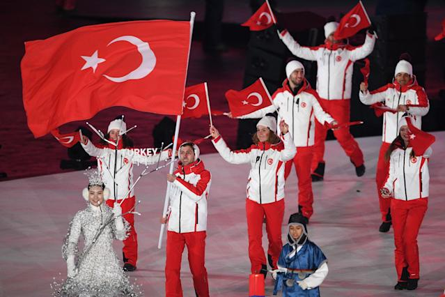 <p>Turkey's flagbearer Faith Aroa Ipcioglu leads the delegation parade during the opening ceremony of the Pyeongchang 2018 Winter Olympic Games at the Pyeongchang Stadium on February 9, 2018. (Photo by ROBERTO SCHMIDT/AFP/Getty Images) </p>