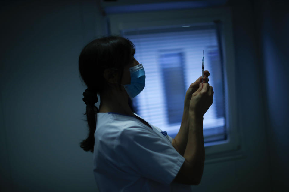 A nurse prepares a syringe with Pfizer/Biontech COVID-19 vaccine as medical workers are vaccinated at the MontLegia CHC hospital in Liege, Belgium, Wednesday, Jan. 27, 2021. The 27-nation EU is coming under criticism for the slow rollout of its vaccination campaign. The bloc, a collection of many of the richest countries in the world, is not faring well in comparison to countries like Israel, the United Kingdom and the United States. (AP Photo/Francisco Seco)