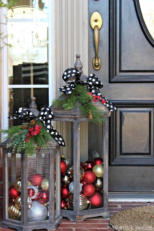 "<p>Fill lanterns with colorful ornaments for a warm and welcoming entryway. We're digging the youthful polka dot ribbons. Get the tutorial at <a href=""http://www.dimplesandtangles.com/2015/12/christmas-tour-part-2-2015-christmas.html?utm_source=feedburner&utm_medium=email&utm_campaign=Feed:+DimplesTangles+(Dimples+%26amp;+Tangles)"" rel=""nofollow noopener"" target=""_blank"" data-ylk=""slk:Dimples and Tangles"" class=""link rapid-noclick-resp"">Dimples and Tangles</a>.</p>"
