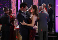 "This 2018 image released by CBS shows Jason Thompson, left, and Amelia Heinle in a scene from the daytime series ""The Young and the Restless."" The series is scheduled to go back into production next week after halting due to the coronavirus epidemic. (Cliff Lipson/CBS via AP)"