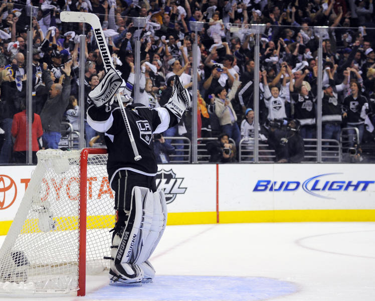 Los Angeles Kings goalie Jonathan Quick raises his arms after the Kings scored an empty-net goal against the St. Louis Blues during the third period in Game 4 of an NHL hockey Stanley Cup second-round playoff series, Sunday, May 6, 2012, in Los Angeles. The Kings won 3-1 to win the series 4-0. (AP Photo/Mark J. Terrill)