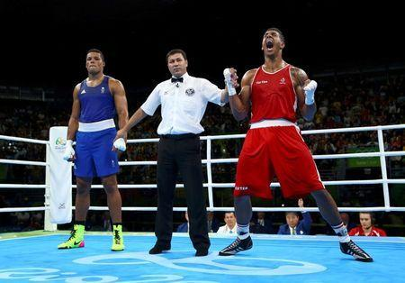 2016 Rio Olympics - Boxing - Final - Men's Super Heavy (+91kg) Final Bout 273 - Riocentro - Pavilion 6 - Rio de Janeiro, Brazil - 21/08/2016. Tony Yoka (FRA) of France celebrates after winning his bout against Joseph Joyce (GBR) of Britain. REUTERS/Peter Cziborra