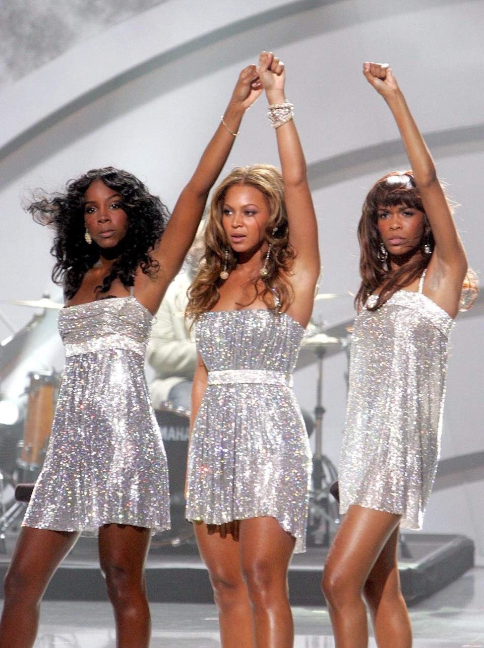 <p>Performing on stage in shimmery silver dresses at the 2005 World Music Awards.</p>